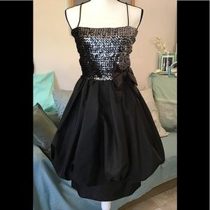 Super cute black & shiny dress. Waist 26""